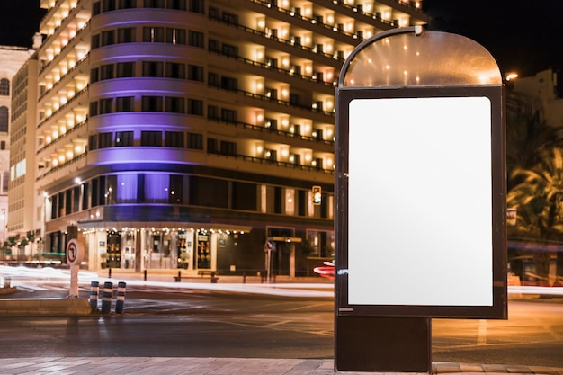 Blank advertisement billboard in illuminated city