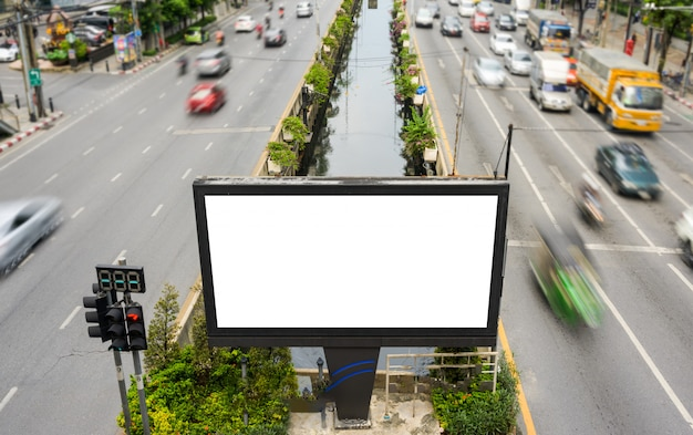 Blank advertisement billboard, information board with traffic lights  on the street. advertising concept