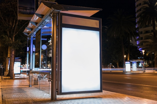 Blank advertising billboard on city bus stop