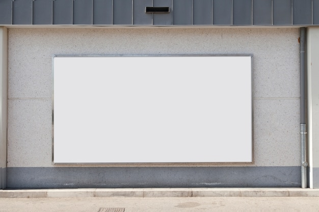 Blank advertising billboard on concrete wall
