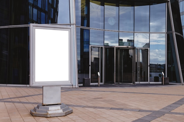 Blank advertising billboard on front of business building.