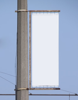 Blank advertising billboard isolated on blue surface