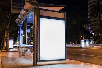 Blank advertising billboard on city bus stop