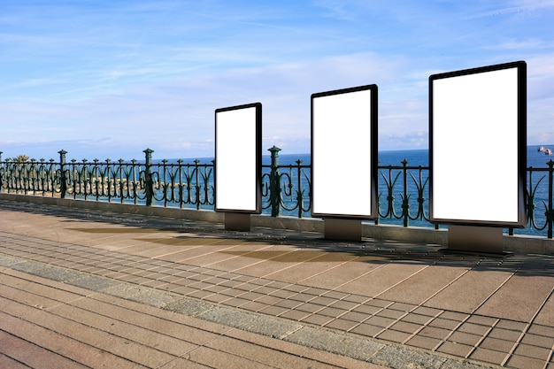 Blank advertising mockup in the street . poster billboard on the beach background
