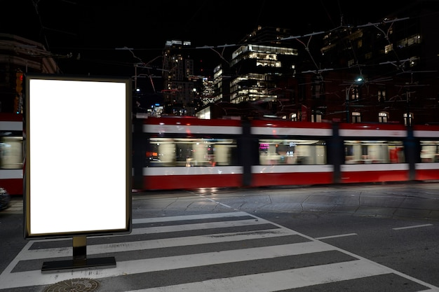 Blank advertising mockup in the street . poster billboard on the city at night background