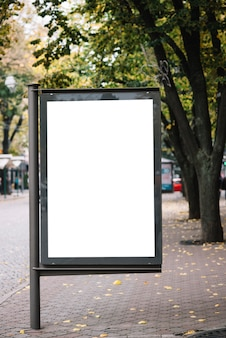 Blank advertising panel on pavement