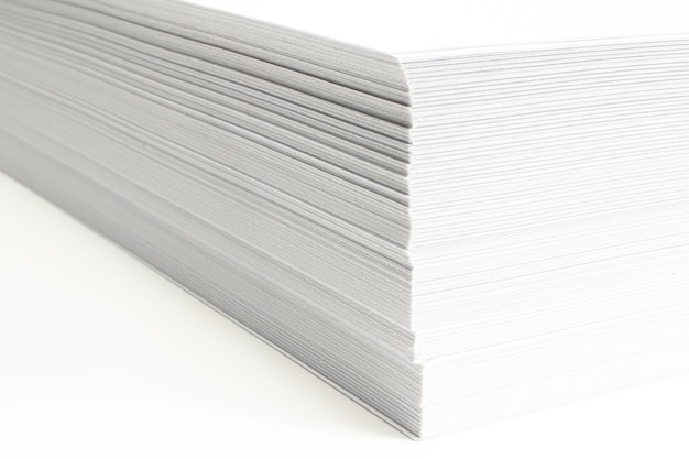 Blank ar letterheads stack macro view with selective focus on white background.