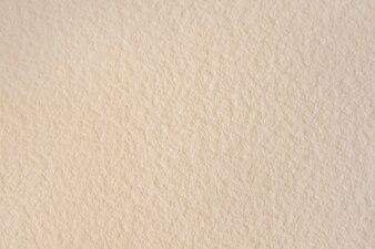 Blank beige textured wallpaper background