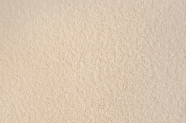 Blank beige textured wallpaper background