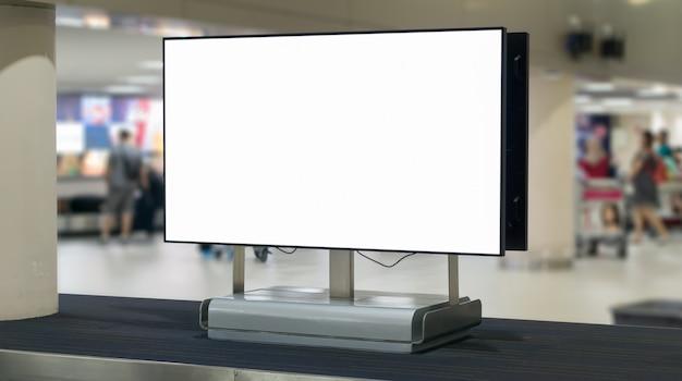 Blank billboard in the airport, empty advertising billboard at aerodrome. Premium Photo