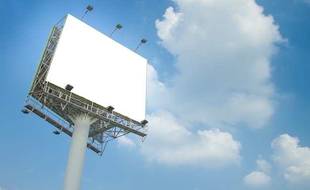 Blank billboard on blue sky with clouds.