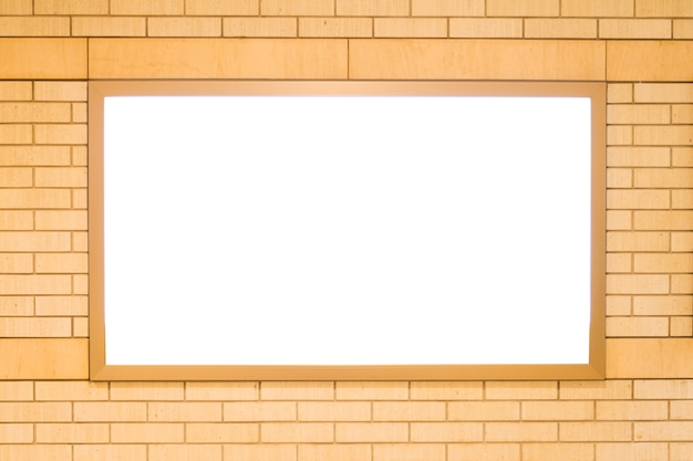Blank billboard on the brick wall