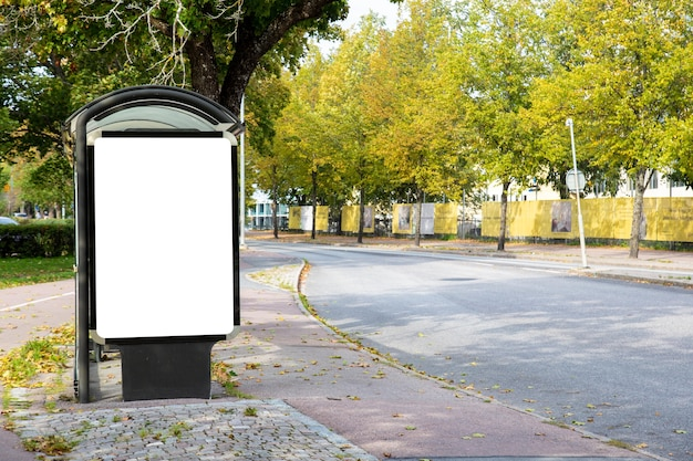 Blank billboard mock up on city road for text message or content.