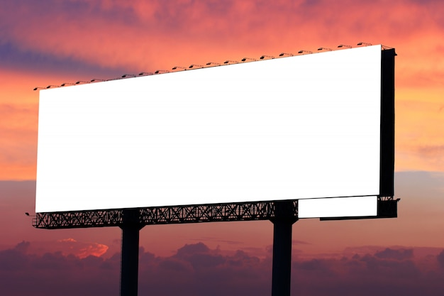 Blank billboard ready for new advertisement on dramatic sunset sky with clouds background