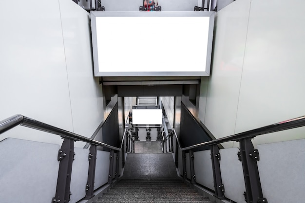 Blank billboard ready for new advertising on the stairs outdoors at skytrain station