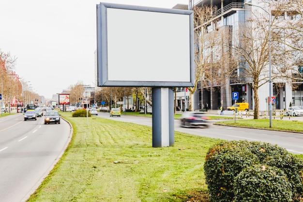 Blank billboard on road in city