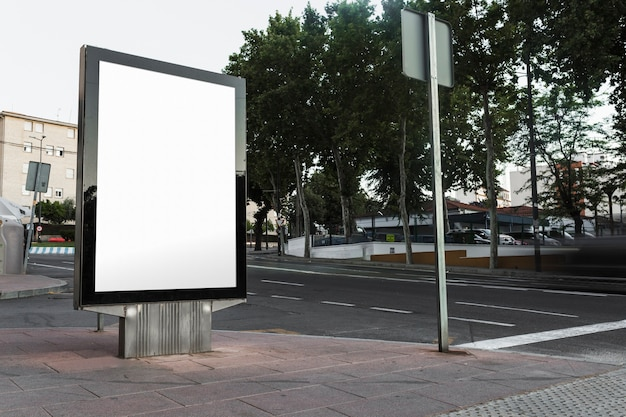 Blank billboard on sidewalk in the city