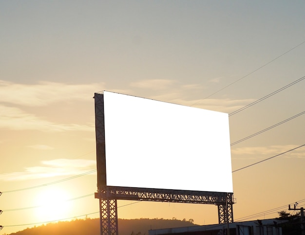 Blank billboard on sunset background for new advertisement