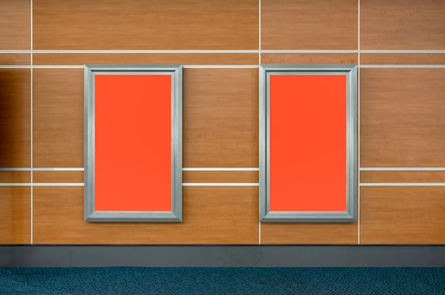 Blank billboard on wooden wall in corridor at the airport