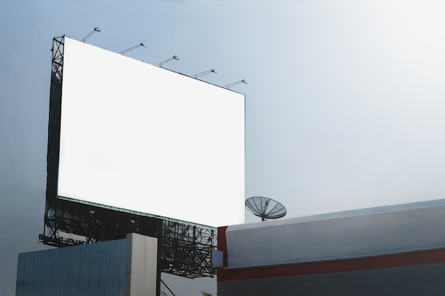 Blank billboards in city with blue sky background