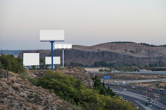Blank billboards for new advertisement on mountain near the highway
