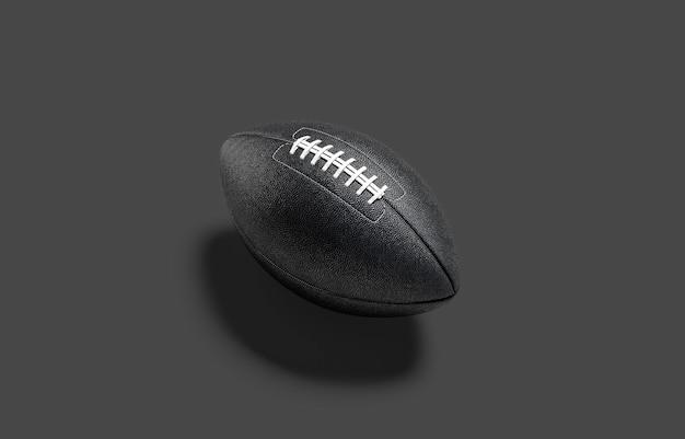 空白の黒いアメリカンフットボールのボールのモックアップペナルティまたはタッチダウンのモックアップのための空のアメリカのサッカーボール