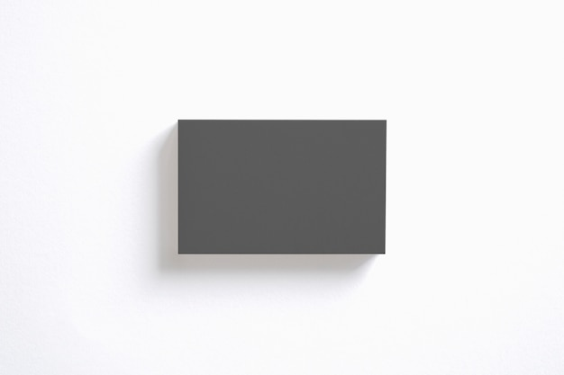 Blank black business cards stack isolated on white. clear template to showcase your presentation.