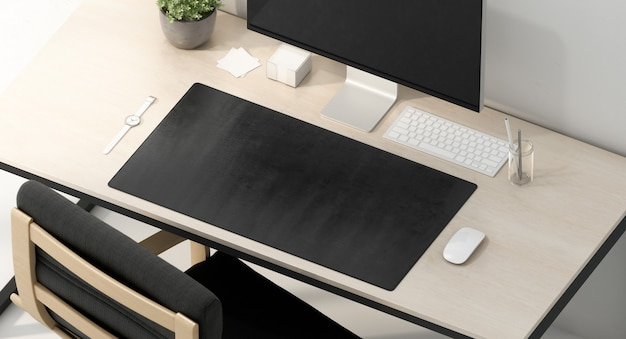 Blank black desk mat on work table , top view, 3d rendering. empty placemat accessory for display and gadget . clear waterproof long surface for keyboard