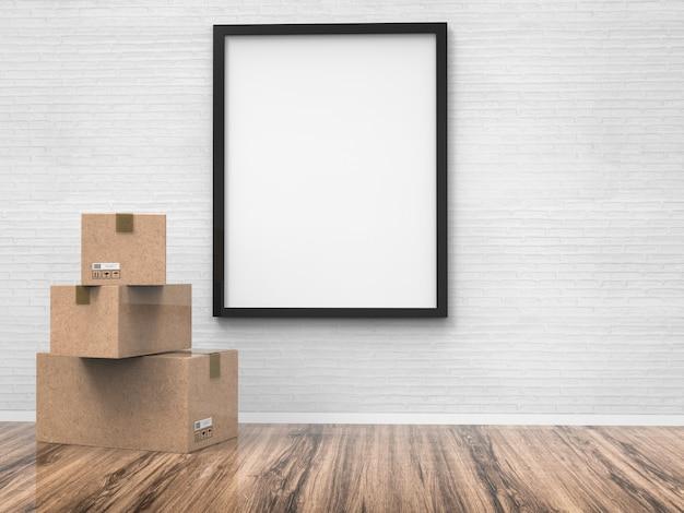 판지 상자가 있는 벽에 매달려 있는 빈 검은색 프레임