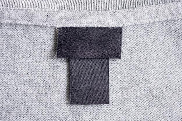 生地の質感に空白の黒いランドリーケア衣類ラベル