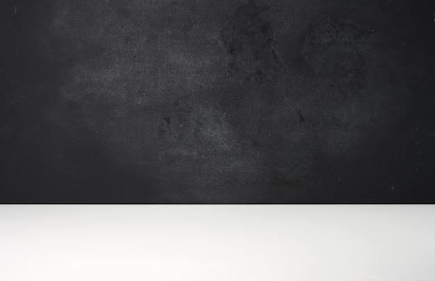 Blank black school chalk board, copy space. white desk