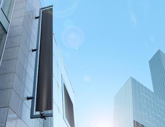 Blank black vertical banner on building facade, design