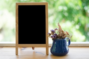 Blank blackboard on the terrace. Copy space concept.