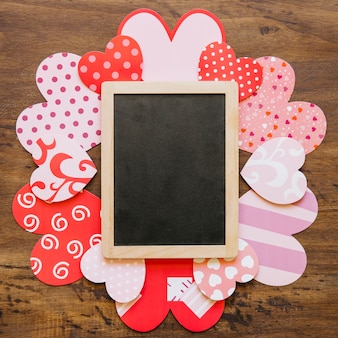 Blank blackboard on pretty hearts