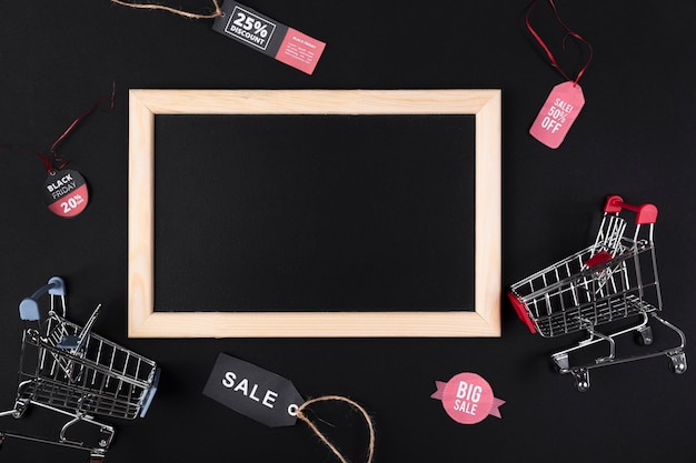 Blank blackboard with shopping carts on the side