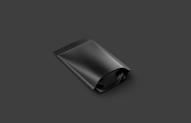 Пустой пустой пластиковый мешочек на молнии, лежащий на темном столе