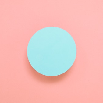 Blank blue circular frame on colored background