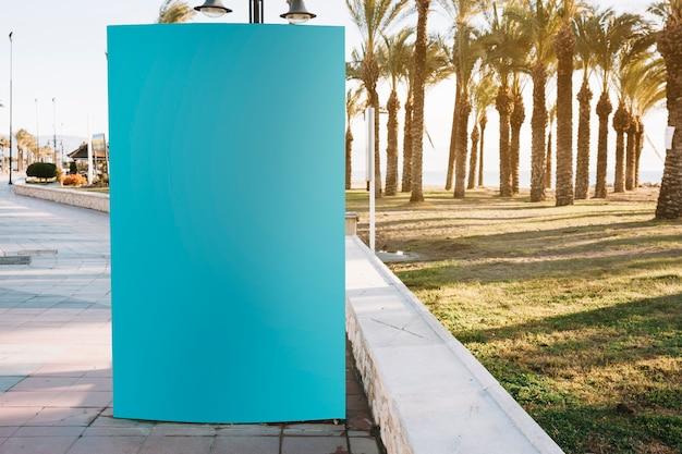 Blank blue stand on roadside