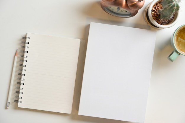 Blank book cover and notepads for text display on white background