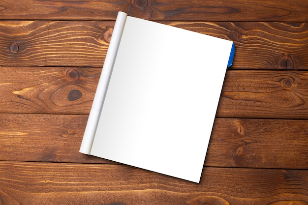 Blank book or magazine cover on wood table