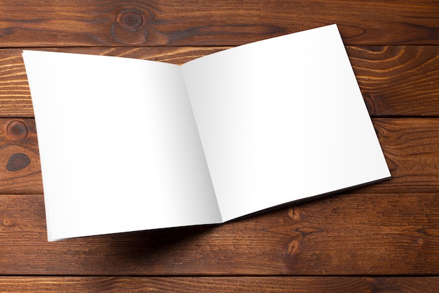 Blank book or magazine cover on wood