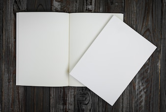 Blank book on a wooden table seen from above