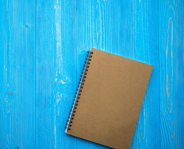 Blank book open on wood background