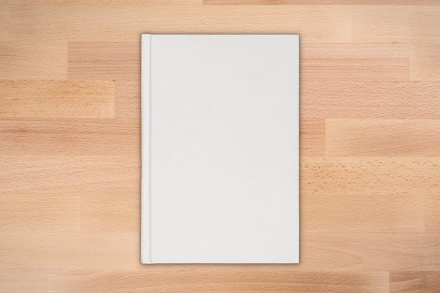 Blank book top view on wooden background