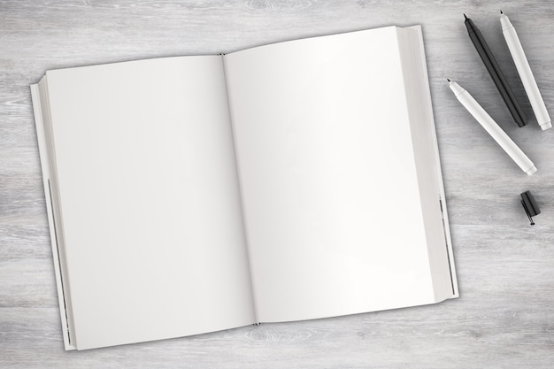 Blank book with pen top view