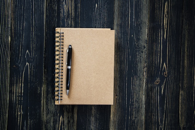 Blank book on wood background