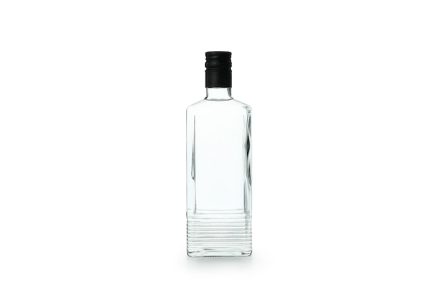 Blank bottle of drink isolated on white wall