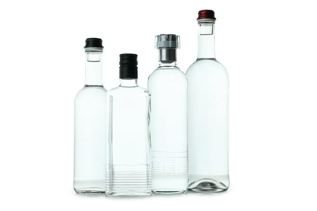 Пустые бутылки водки на белом
