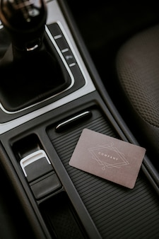 Blank brown business card template on a center of car console space