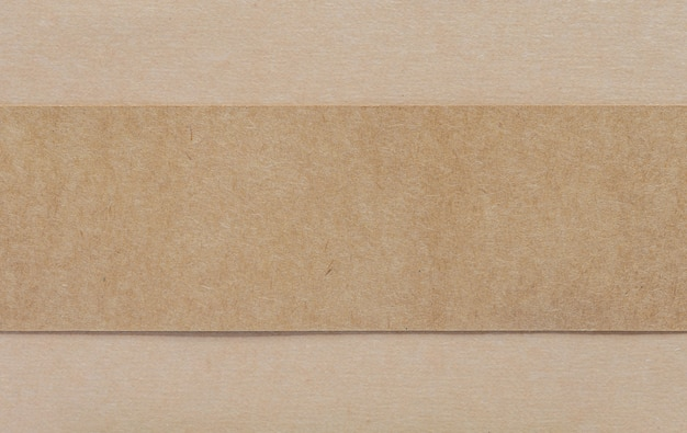 Blank brown paper on brown cardboad background